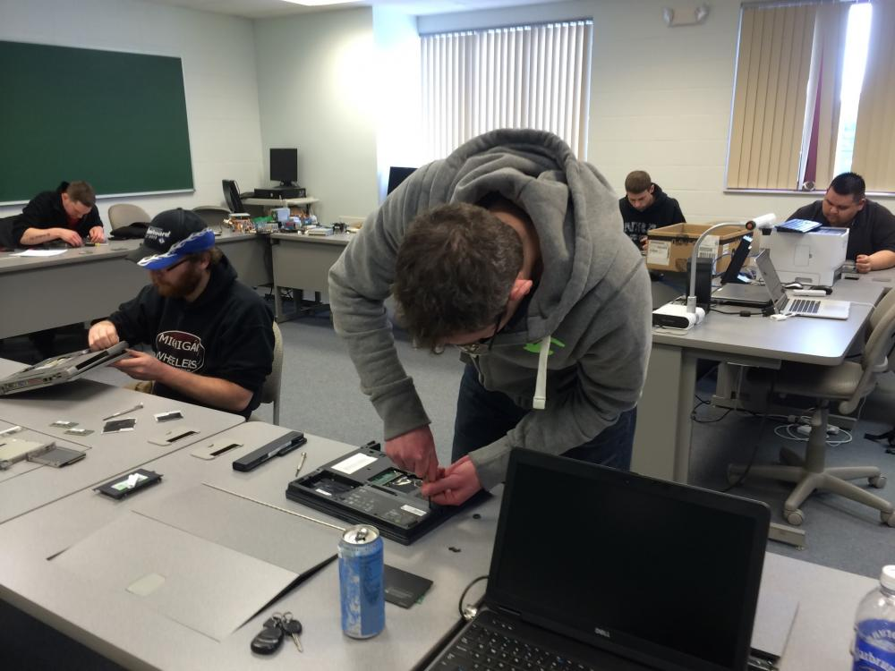 A picture of students working in a computer hardware class.