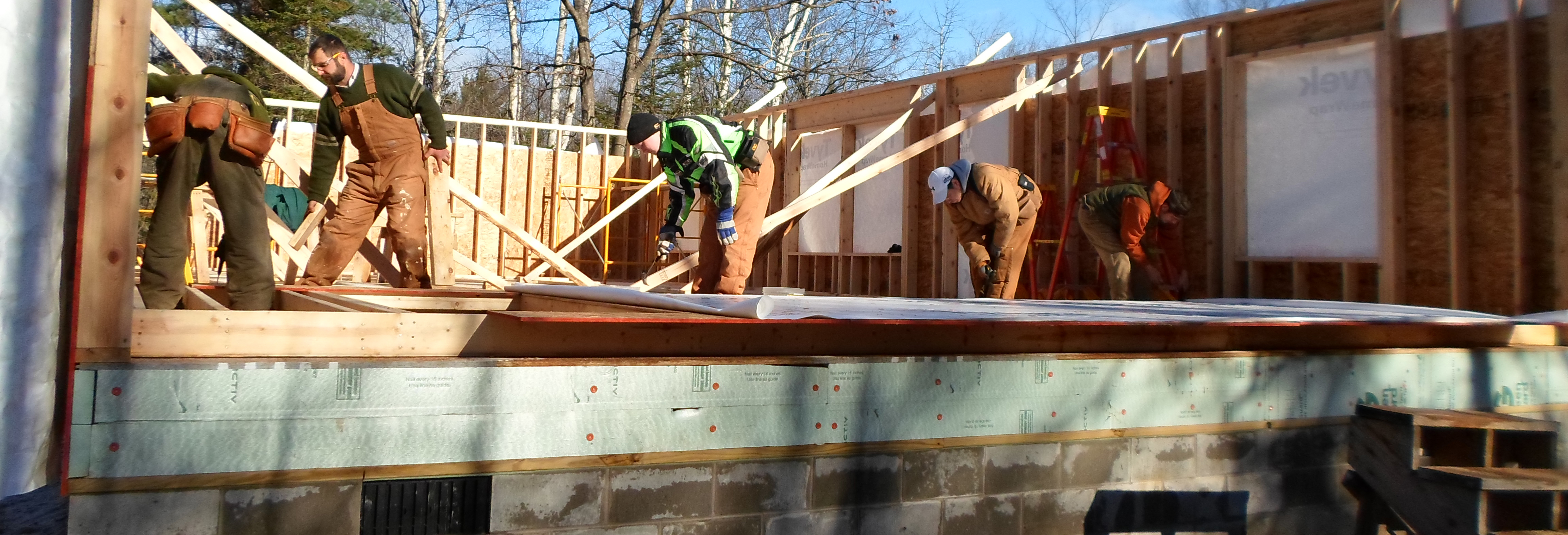 Students and Instructor working on building frame to a house