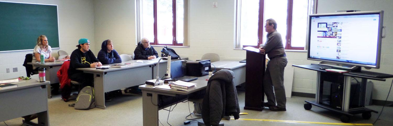 John White teaching one of his business classes.