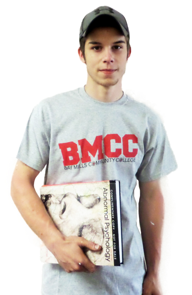 BMCC Student holding Psychology Book